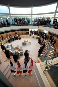 Everyone is on their feet during the historic devolution signing in Yellowknife in March.