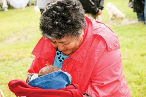 Fort McMurray elder Violet Clarke beams proudly at her newborn great-grandson, born in a teepee at midnight on Thursday evening, the eve of the Healing Walk.