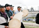 Drummers from the Dene Tha First Nation in northwestern Alberta, the site of a recent pipeline spill termed the most devastating in Alberta's history, lead marchers past Syncrude's oilsands upgrading facilities on the fourth annual Tar Sands Healing Walk on Saturday north of Fort McMurray.