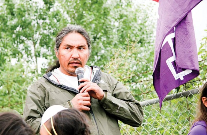 Athabasca Chipewyan First Nation Chief Allan Adam addresses the media during a press conference at the start of the fourth annual Tar Sands Healing Walk on Saturday.