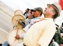 Dene National Chief Bill Erasmus marches with drummers from the Dene Tha First Nation in northwestern Alberta.