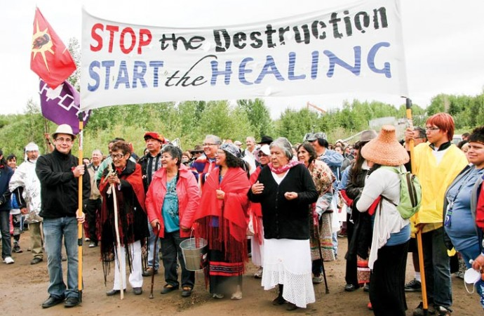 Elders lead hundreds of Healing Walk participants out of Crane Lake park Saturday.