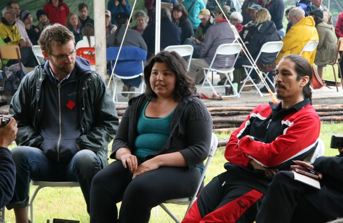 Vanesse Grey of the Aamjiwnaang First Nation (centre) discusses impacts of the oilsands industry, along with Mike Hudema of Greenpeace (left) and Lionel Lepine of the Athabasca Chipewyan First Nation during Friday's workshops.