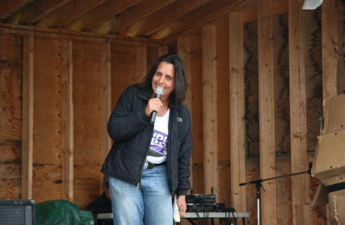 Indigenous environmental activist Winona LaDuke of Minnesota speaks Friday night at the Healing Walk camping grounds.