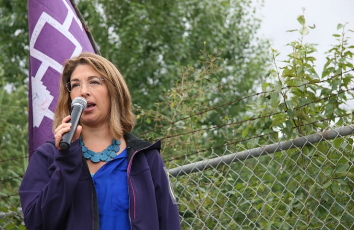 Author and activist Naomi Klein addresses the media Saturday morning before the walk at Crane Lake park.