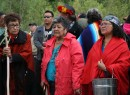 Elders (from left) Nancy Scanie, Violet Clarke and Cleo Reece lead the march out of Crane Lake park.