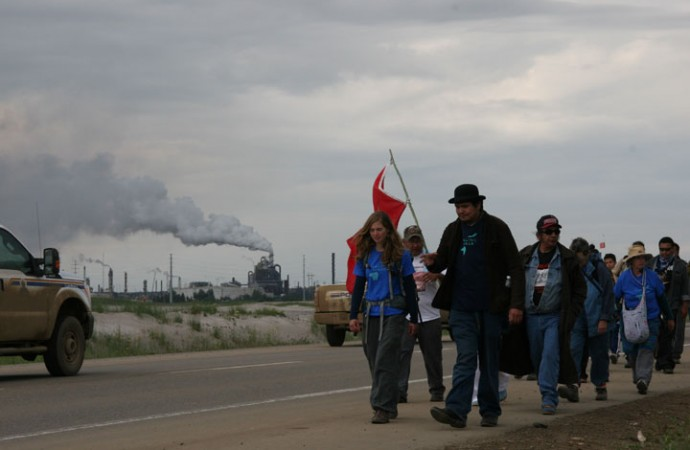 "Walkers round the north bend of the 14-km ""tar sands loop"" where elders gather to make an offering."