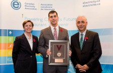 Darren Hazenberg, centre, accepts the CEA Lifesaving Award from federal labour minister Kellie Leitch and Western Arctic MP Dennis Bevington at an awards reception in Ottawa.