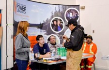 A community member from Whatì checks out the NWT Power Corp. booth at the career fair last week.