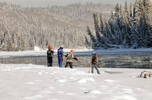 A water testing team takes samples from the Athabasca River checking for contaminants from the massive tailings pond plume from Sherritt International's Obed Mountain coal mine.