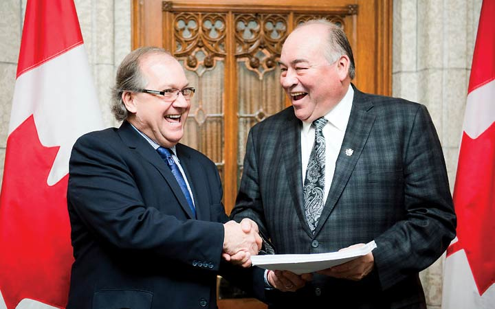 Aboriginal Affairs and Northern Development minister Bernard Valcourt and NWT Premier Bob McLeod shake hands during the premier's visit to Ottawa last week to watch the tabling of the devolution bill.