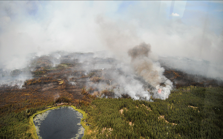 A fire burns near Behchoko to the west of Yellowknife. Fires around the capital have filled the city with smoke for weeks, often ranking extreme in terms of poor air quality.