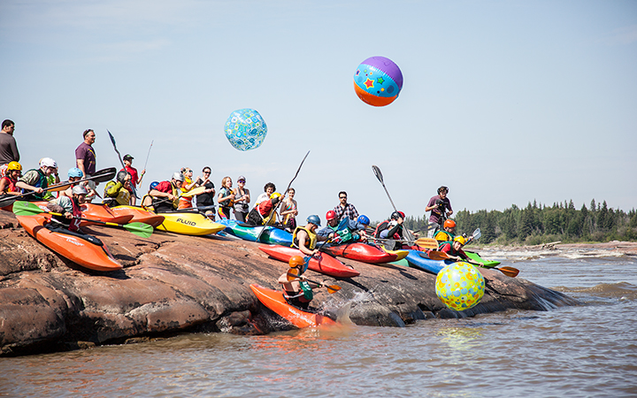 Last year's Paddlefest attendees play around at Mountain Portage rapids. This year's event will take place from Aug. 1 to 4.