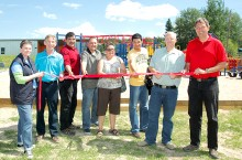 Officials from Keyano College, the Regional Municipality of Wood Buffalo and the Province of Alberta officially open a new playground in Fort Chipewyan on June 25.