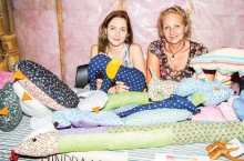 "Summer Splash artist Marissa Zele and her mom Bozena Robertson sell Zele's handmade ""Snuggies"" as a fund raiser for the aspiring sculptor's post-secondary schooling. The seasonal festival celebrating the arts in Fort Smith ran from Aug. 8 to 17 this year, with workshops for aspiring crafters happening all week."