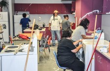 A team of volunteers from the community of Fort Providence helps clean a classroom after it was splattered with paint by an unknown vandal on Aug. 11.