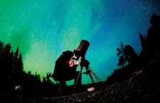 Astronomer Larry Nixon peers into his Celestron SE8 telescope at Pine Lake in the Dark Sky Preserve on Friday evening. On the clear night, Nixon was able to catch glimpses of the Ring Nebula, double stars and the planet Neptune.