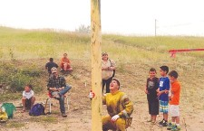 Darwin Tourangeau tries his hand at climbing a greased pole in an attempt to capture the cash prize at the top, one of the main events at Fort Chipewyan's Heritage Day, hosted by the Bicentennial Museum on Aug.4. The annual event is a celebration of the area's history, with Aboriginal and non-Aboriginal groups alike hosting cultural activities throughout the day.