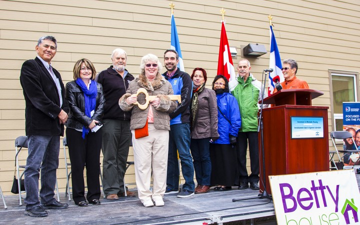 YWCA executive director Lyda Fuller receives a ceremonial key from the city, with the support of Housing Minister Robert C. McLeod; Fatima Barros of the Canada Mortgage and Housing Corp.; Bob Gannicott, Dominion Diamond Corp.; Yellowknife Mayor Mark Heyck; Linda Bussey, Community Advisory Board on Homelessness; Elder Marie Speakman; Bob O'Rourke, Yellowknife Community Foundation; and Yellowknife MLA Wendy Bisaro.