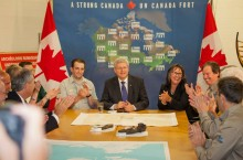 Prime Minister Stephen Harper and Minister Leona Aglukkaq join the Parks Canada crew in celebrating the discovery of one of Sir John Franklin's ill-fated ships on the ocean floor in the Northwest Passage.