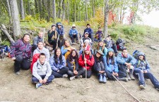 Grade 8 students from Paul William Kaeser high school take a break from one of their outdoor adventures at Sweetgrass Landing.  The students got to spend four days learning on the land.