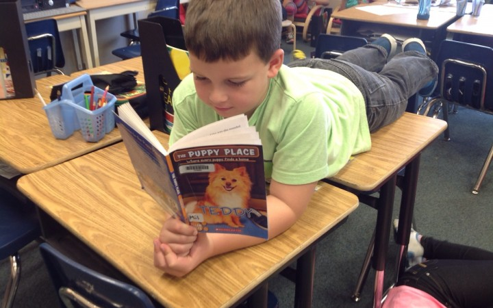 Chayce Beck, a Grade 3 student at Harry Camsell School in Hay River, enjoys a book last week during a school-wide reading event celebrating NWT Literacy Week. Schools across the territory took part in storytelling, reading and games related to literacy.