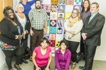 Members of the FASD committee present a community quilt to Health Minister Glen Abernethy.