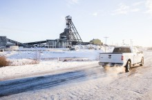A truck rolls past Giant Mine on the new bypass road, which opened last January.