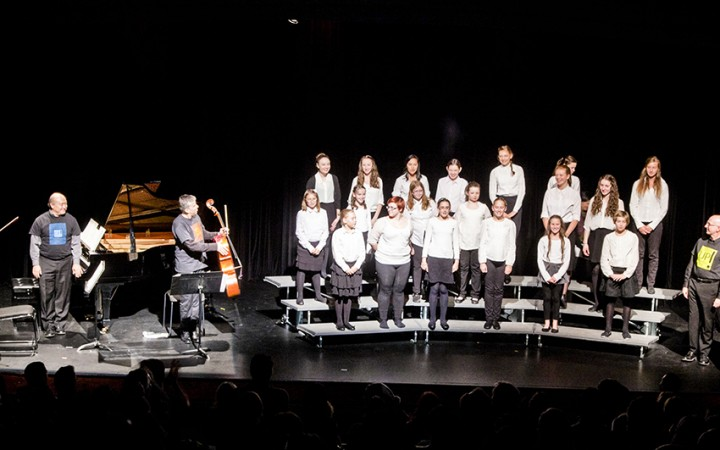 The Yellowknife Youth Choir's spirited performance brought the NACC house to its feet Saturday. Directed by Susan Shantora and backed up by the classical chamber accompaniment of the Gryphon Trio, the choir is just one of many student groups which will collaborate on the Listen Up! creative music project.