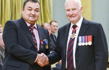 Mike Sharpe of Hay River accepts his Medal of Bravery from Governor General David Johnston in Ottawa Oct. 21.