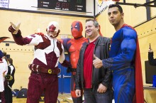 Surrounded by Super Heroes: Yellowknife MLA Glen Abernethy, who came dressed as himself, is in good company with Captain Canuck, Spiderman and Superman. Abernethy, a closet Star Trek fanatic, loaded up on comic books at the Ptarmicon 3 event in Yellowknife on Saturday.