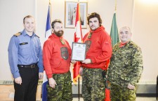 Ranger Sgt. Alexander Kidd and Cpl. Derek Erasmus, centre, of Fort Simpson accept the first place team award from Cpt. (Navy) Brad Peats, Deputy Commanding Officer of Joint Task Force North, and Sgt. Stephane Gelinas, Ranger Instructor, 1 Canadian Rangers Patrol Group.