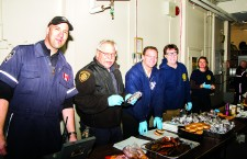 Jason Panter, left, William Reimer, Dave Porter and Paul Bannister serve up burgers at Fort Smith's Burnt Offerings BBQ on Oct. 9. The Fort Smith team was one of the fire departments given a 2014 NWT Fire Service Merit Award last week.