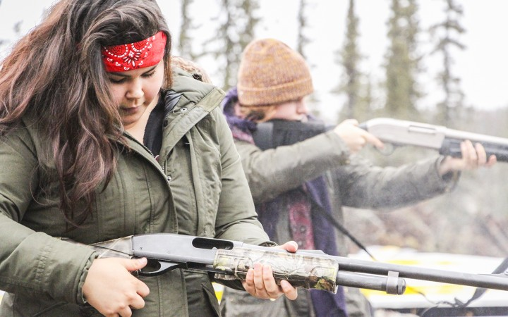 Students Rebecca Grooms, 19, of Yellowknife (foreground) and Kira Anderson, 21, of B.C. practice shooting shotguns during fire arms certification at Dechinta.
