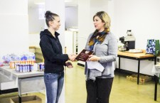 Ashley Ward, left, receives an award for getting top marks in Aurora College's parts technician apprenticeship program in 2013, given to her by ITI career development officer Sylvie Tordiff. Ward worked hard and received the same award this year.