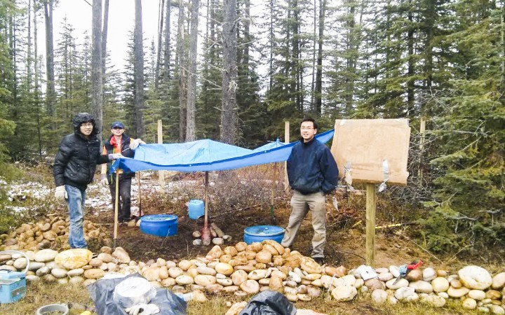 University of Alberta seismologist Jeff Gu, right, conducts seismic testing with two PhD students Yuanyin  Zhang, front, and Yunfeng Chen. Here they are conducting seismic mapping at a station near Swan Hills, Alta., part of the Canadian Rockies and Alberta Network (CRANE).