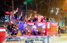 Santa Claus and his merry team of Hay River firefighter elves usher in the Christmas season at the town's annual parade. Below, the Kingland Ford Sales float features sales manager-turned-crooner Steve Moll belting out some holiday classics.
