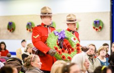 RCMP officers Cpl. Greg Morrow and Cst. Jonathan Newcombe carry a wreath to be laid next to the cenotaph at the Remembrance Day ceremonies at Royal Canadian Legion Branch #250 in Hay River on Nov. 11.