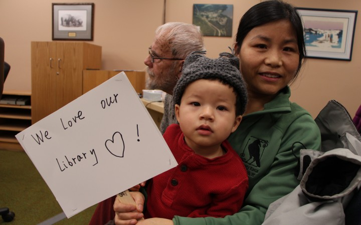 Oliver Raab and his mom Min Sun show their support for the Mary Kaeser library at a Fort Smith town council meeting Dec. 9.