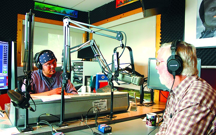 CKLB Radio director Deneze Nakehk'o, left, speaks with Weledeh MLA Bob Bromley on the air during the radio's sign-off party on July 31 last year. There has been no news or Aboriginal language programming on CKLB since the shut down, which the Native Communications Society blamed on late and inconsistent funding from the federal government.