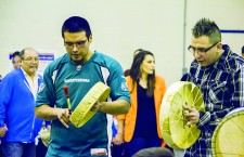 Bryce Fabian, left, and Darren Mercredi perform with their fellow drummers at the second annual Amber Alyssa Tuccaro Memorial Round Dance, held in Fort Chipewyan Jan. 17. The community celebrated the murdered woman's life while spreading awareness on the national issue.