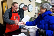 """Hay River resident Beatrice Lepine trades in her """"World's Best"""" lake trout recipe at the Super A grocery store on Saturday for a free fillet from Hay River North MLA Robert Bouchard."""