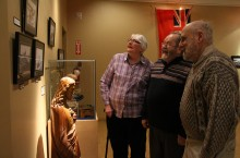Museum volunteer Ray Currie, centre, shares a laugh with his wife Donna and Fort Smith resident Richard Daitch while looking back at some photos featured as part of the Northern Homeland exhibit at the Northern Life Museum and Cultural Centre.