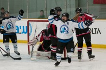 Team NWT women's hockey player Davina McLeod scores against Team Yukon Feb. 19 in their final game of the 2015 Canada Winter Games. The women won against their nemesis to the west twice in the tournament, taking 11th place. For more on Team NWT's performance in the games.