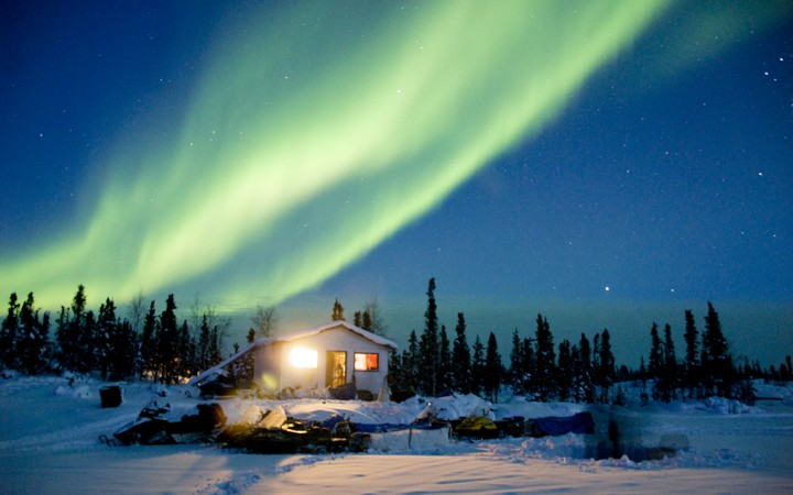 Northern Lights shine over a cabin in the East Arm, where negotiations to create a national park around the community of Lutsel K'e have been ongoing for over three decades.