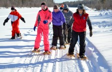 Ken and Mary Schaefer welcomed groups of students to their bush camp last week for lessons in traditional skills and living off the land. Here Mary, right, demonstrates the technique of walking with snowshoes.