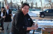 Eileen Beaver makes bannock on a stick for the students and their families to enjoy.