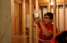 Deninue School student Isaac Simon practises wiring an outlet in the electrician stream. Each student spent the week of Mar. 15 to 19 learning a dedicated trade.