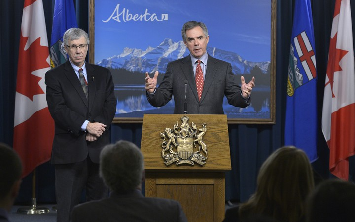 Alberta Minister of Finance Robin Campbell, left, and Premier Jim Prentice turned to high taxation in the 2015 Capital Plan, to adjust for falling oil prices and the impact on Alberta's economy.