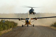 Pilots use a Canadian Forces CC-138 Twin Otter and CH-146 Griffon helicopter to conduction aviation drills on the Dempster Highway just west of Tsiigehtchic during Operation Nanook in 2012.